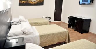 萨尔塔卢克索酒店 - 萨尔塔 - 睡房