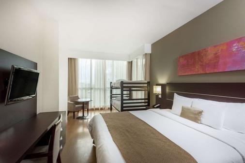 巴拿马中央温德姆特里普酒店 - 巴拿马城 - 睡房