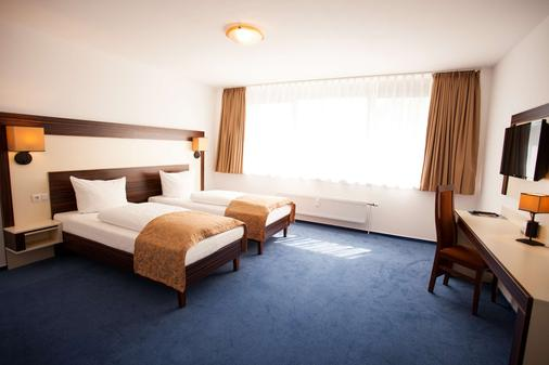 塞勒托尔中心酒店 - 布伦瑞克 - 睡房