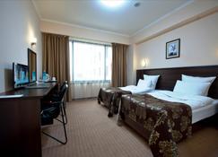 阿塔肯特公园西佳Plus酒店 - 阿拉木图 - 睡房