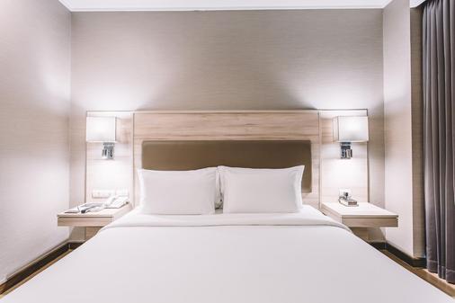 曼谷阿德菲套房酒店 - 曼谷 - 睡房