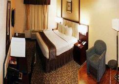 杰克逊堡贝尔蒙特套房酒店 - 哥伦比亚 - 睡房