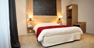 瓦纳中心基里雅德酒店 - 瓦纳 - 睡房