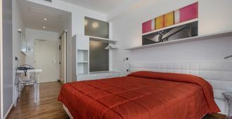 国际酒店 - 马尔切西内 - 睡房