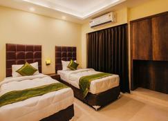 特雷布山景酒店 - 西里古里 - 睡房