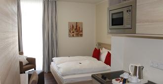 顶级 20 服务式公寓酒店 - 法兰克福 - 睡房