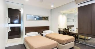 墨尔本南方大酒店 - 墨尔本 - 睡房