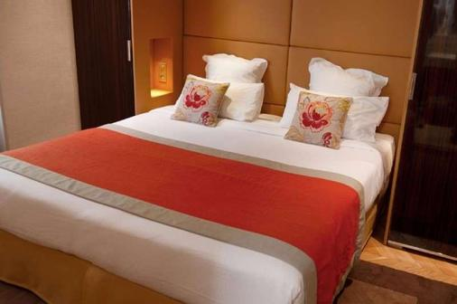 旅游大道酒店 - 巴黎 - 睡房