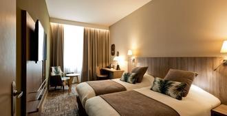 贝斯特韦斯特里昂克雷吉酒店 - 里昂 - 睡房