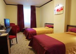 格罗西福公园酒店 - 基辅 - 睡房
