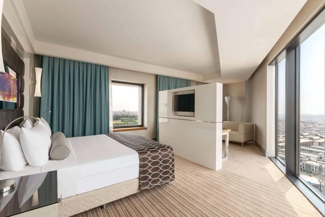 特克斯迪尔肯特华美达广场大酒店 - 伊斯坦布尔 - 睡房