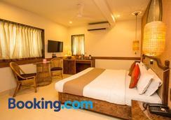 和谐酒店 - 孟买 - 睡房