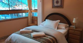 瓦楚玛住宿加早餐酒店 - 马丘比丘 - 睡房