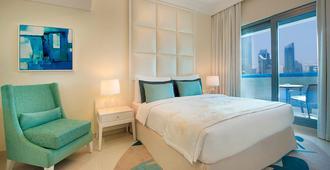 迪拜购物中心街达玛克酒店 - 迪拜 - 睡房