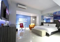 阿米迪亚G套房酒店 - 泗水 - 睡房