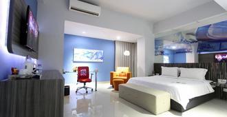 阿米迪亞G套房飯店 - 泗水 - 睡房