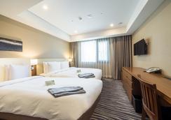 釜山商务酒店 - 釜山 - 睡房