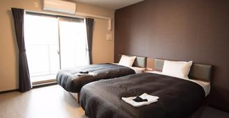 Trad酒店 - 大阪 - 睡房