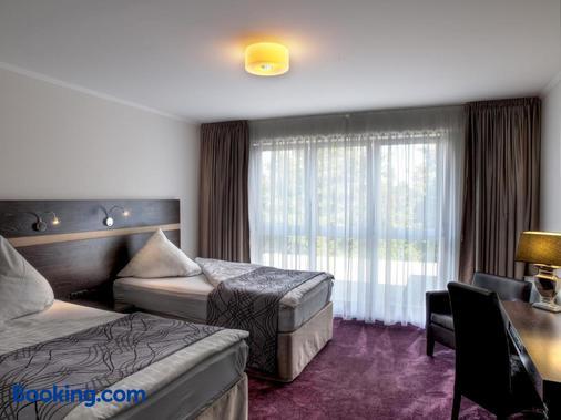 洛可特运动酒店 - 汉堡 - 睡房