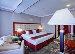 路路酒店 - 比什凱克 - 睡房