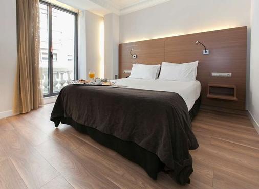 萨拉戈萨中心文奇酒店 - 萨拉戈萨 - 睡房