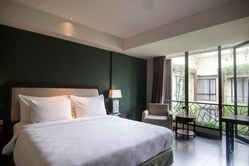 雨林瑞士贝尔酒店 - 库塔 - 睡房