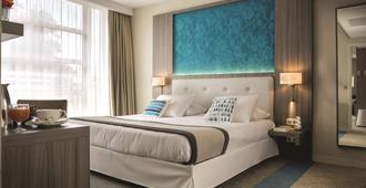 艾克斯莱班金色郁金香Spa酒店 - 艾克斯莱班 - 睡房