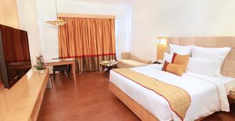 万寿菊格林公园酒店 - 海得拉巴 - 睡房