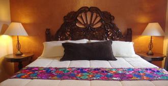 罐头之家酒店 - 圣米格尔-德阿连德 - 睡房