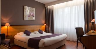 瓦尼斯芒什海洋原创城市酒店(国际酒店) - 瓦纳 - 睡房