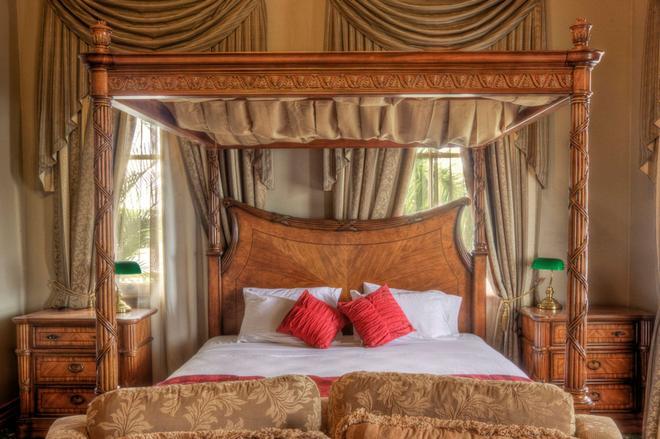 丹尼森精品酒店-阿桑德连锁酒店成员 - 洛坎普顿 - 睡房