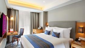 旁多克英达瑞士贝尔酒店国际 - 雅加达 - 睡房