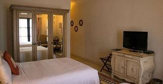 卡萨普利玛维拉精品Spa酒店 - 圣米格尔-德阿连德 - 睡房
