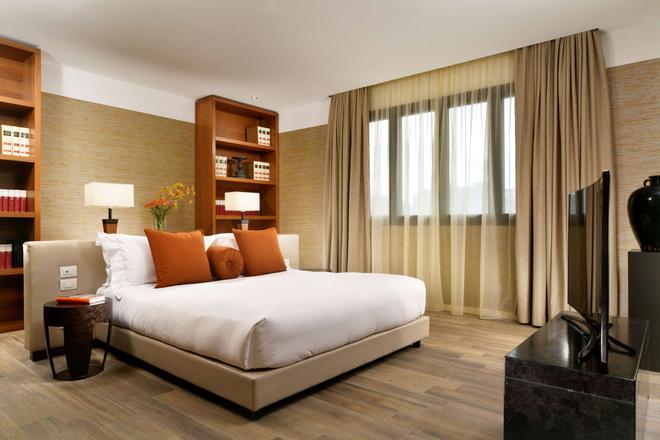 米兰套房酒店 - 米兰 - 睡房