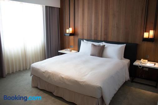 Hotel Wo窩 - 高雄市 - 睡房
