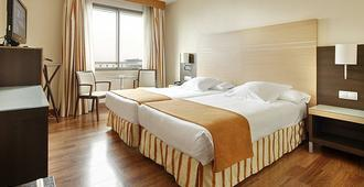纳瓦拉女王布兰卡酒店 - 潘普洛纳 - 睡房