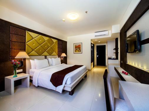 巴厘岛阿斯顿库塔酒店 - 库塔 - 睡房