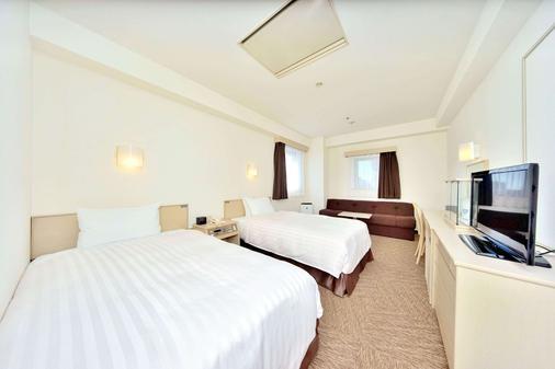冢本橡树里兹酒店 - 大阪 - 睡房