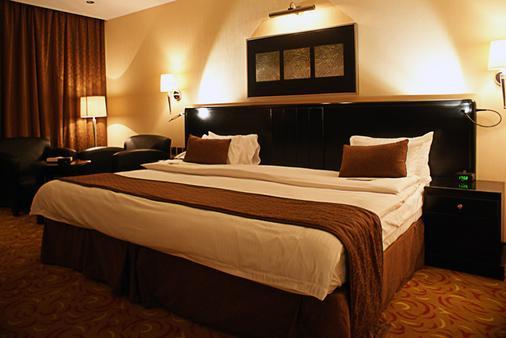 瓦哈宫酒店 - 利雅德 - 睡房