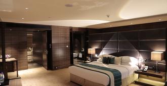 撒哈拉之星酒店 - 孟买 - 睡房