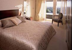 泰姬庞莫奇酒店 - 路沙卡 - 睡房