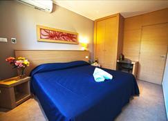 姆恩里弗度假酒店 - 塔兰托 - 睡房