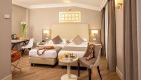 卢朵维斯宫酒店 - 罗马 - 睡房