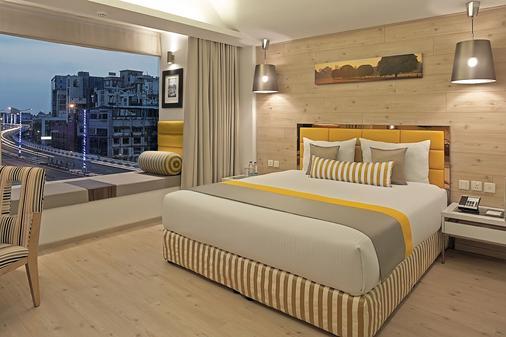 巴尔萨纳精品酒店 - 加尔各答 - 睡房