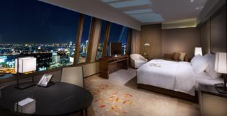 曼谷大仓新颐酒店 - 曼谷 - 睡房