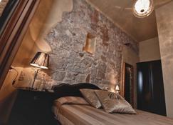 罗坎达康特马梅利酒店 - 奥尔比亚 - 睡房