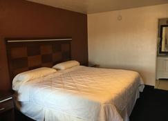 罗斯威尔国家9号旅馆 - 罗斯威尔 - 睡房