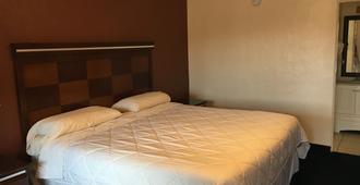 罗斯威尔国家 9 号旅馆 - 罗斯威尔