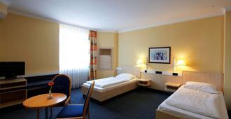 施特拉尔松德城际酒店 - 施特拉尔松 - 睡房