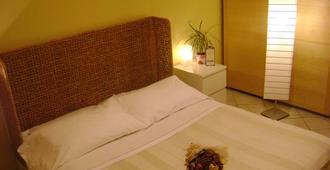 周末住宿酒店 - 曼托瓦 - 睡房
